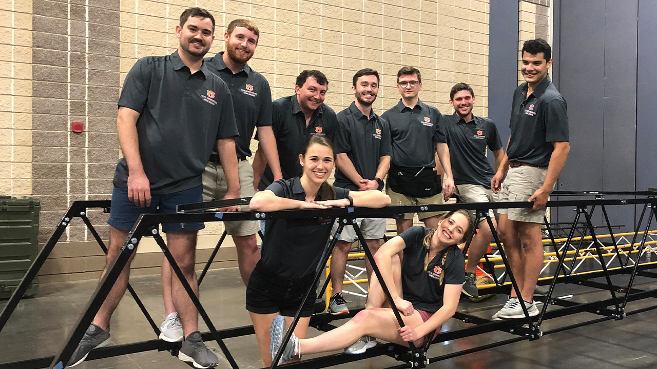 Members of the Auburn University student chapter of the American Society of Civil Engineers pose while competing in the organization's annual steel bridge competition.