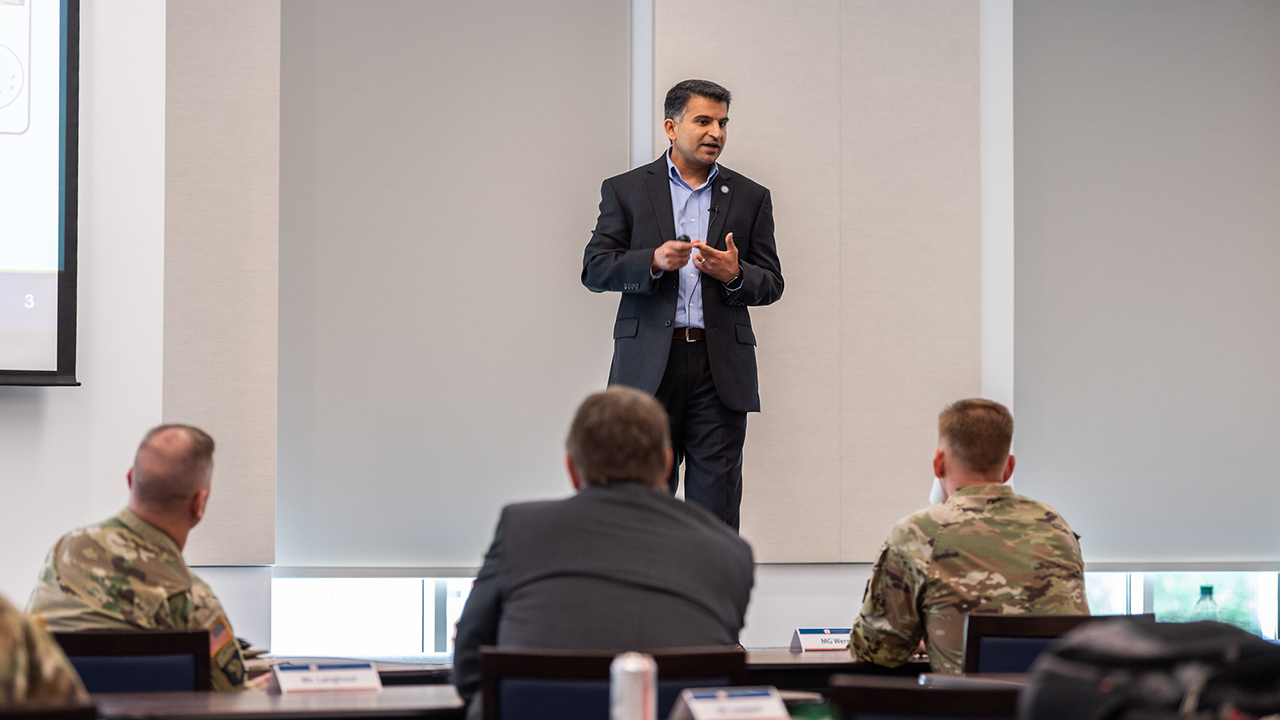 Nima Shamsaei, director of Auburn's National Center for Additive Manufacturing Excellence, speaks on qualification for additively manufactured materials and parts at the recent Army Additive Manufacturing Summit. Seated, from left to right, are: Maj. Gen. K. Todd Royar, commandinggeneral of U.S. Army Aviation and Missile Command; Jeffrey Langhout, director of the U.S. Army Combat Capabilities Development Command Aviation & Missile Center; and Maj. Gen. Darren L. Werner,commanding general of the U.S. Army Tank-automotive and Armaments Command.