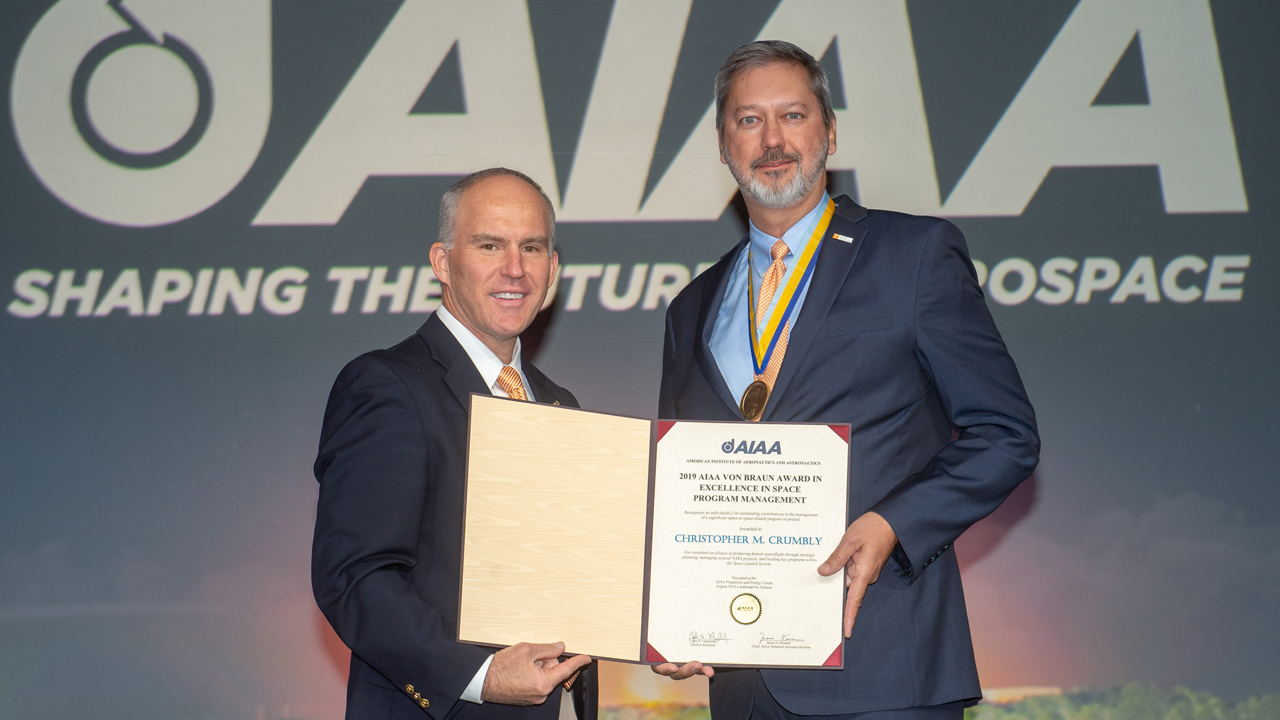 Chris Crumbly receives the 2019 Von Braun Award for Excellence in Space Program Management at the 2019 Propulsion and Energy Forum.  From left: Mark S. Whorton, space and missiles group director, and Chris Crumbly.