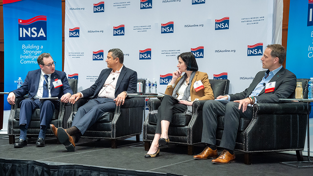 "Daniel Tauritz (left) moderated a panel discussion on the ""Use of AI for Cybersecurity."""