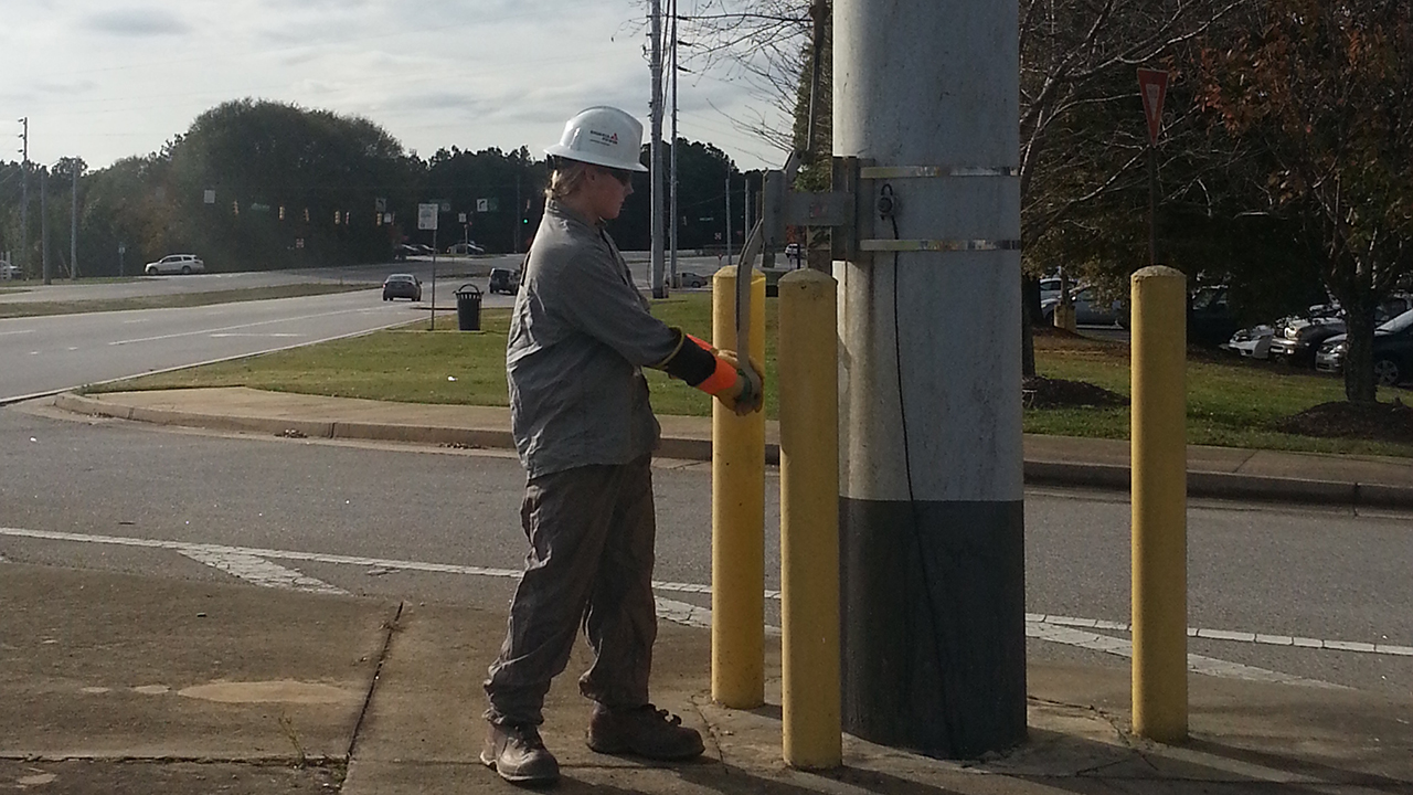 Daylon Hester closes a gang switch to tie two substations together during his co-op with Georgia Power Co.