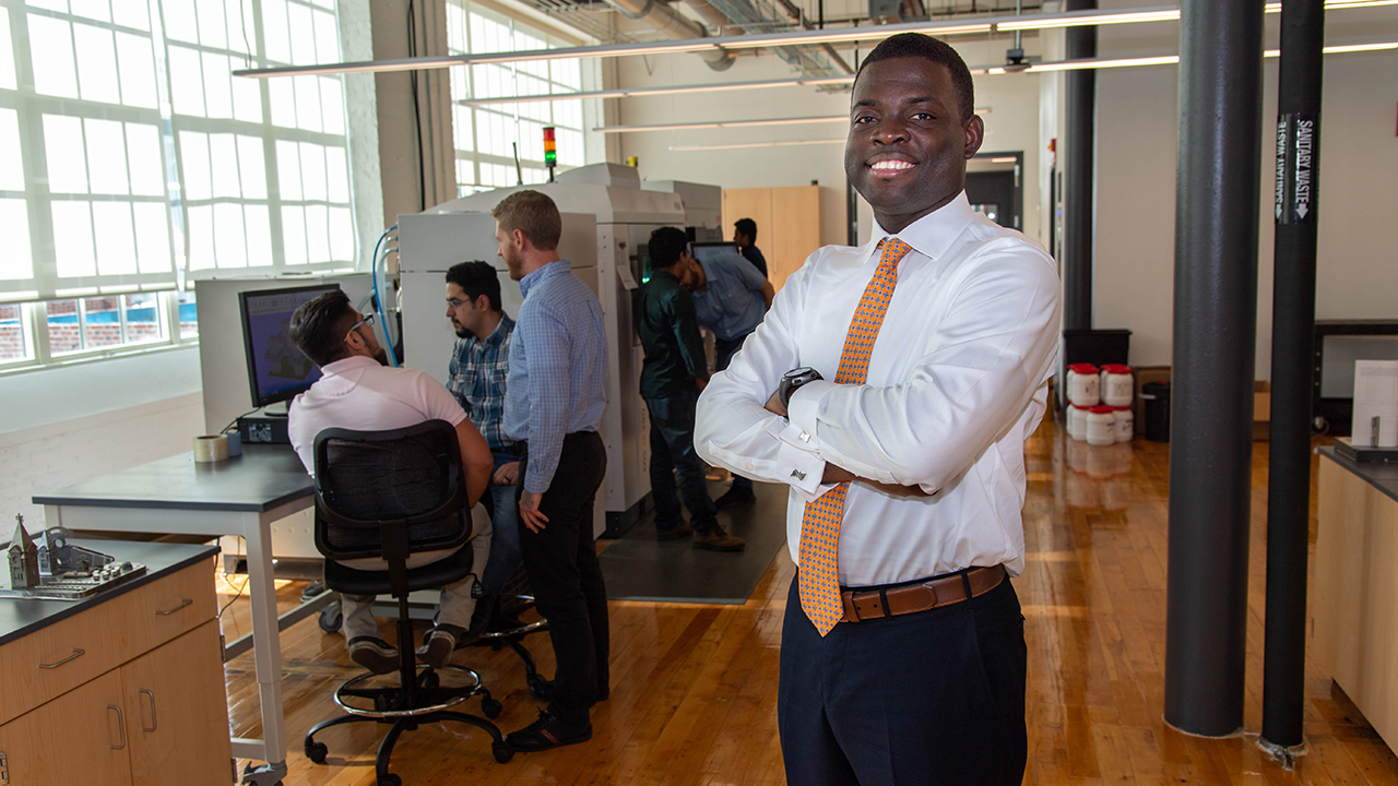 Emmanuel Winful is pictured in the Gavin Engineering Research Laboratory with researchers in the National Center for Additive Manufacturing Excellence.