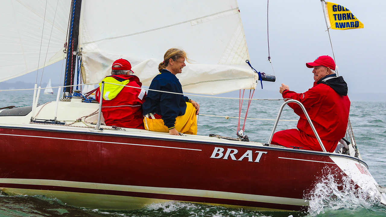 John Henley sailing with Debbie Riddle and Jim Wilson