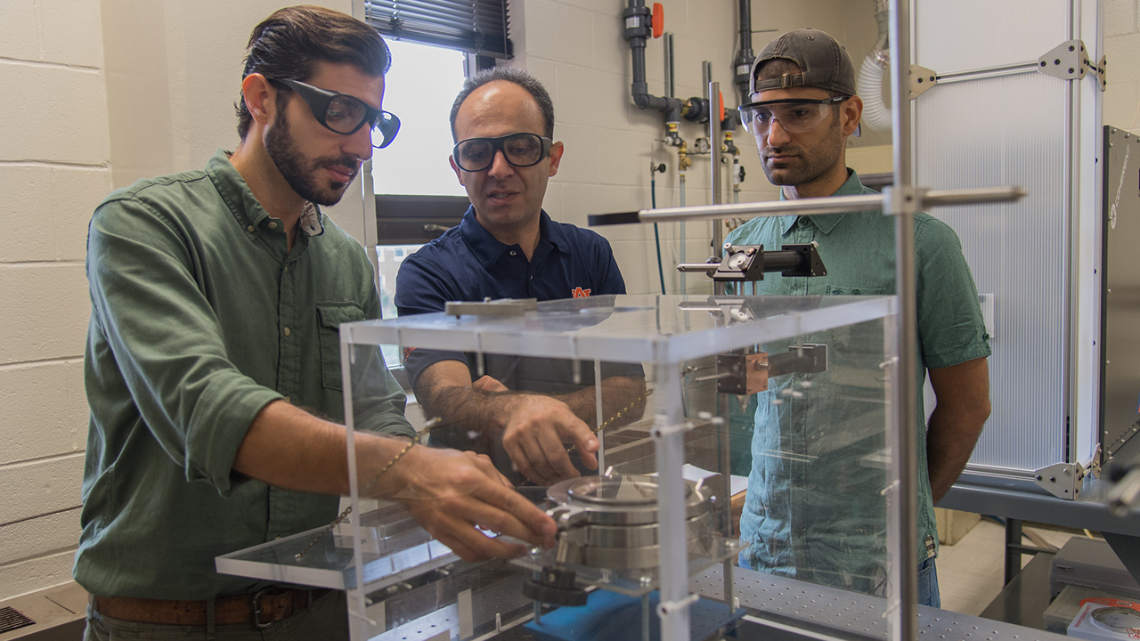 Researchers are pictured in assistant professor Masoud Mahjouri-Samani's Laser-Assisted Science and Engineering lab.
