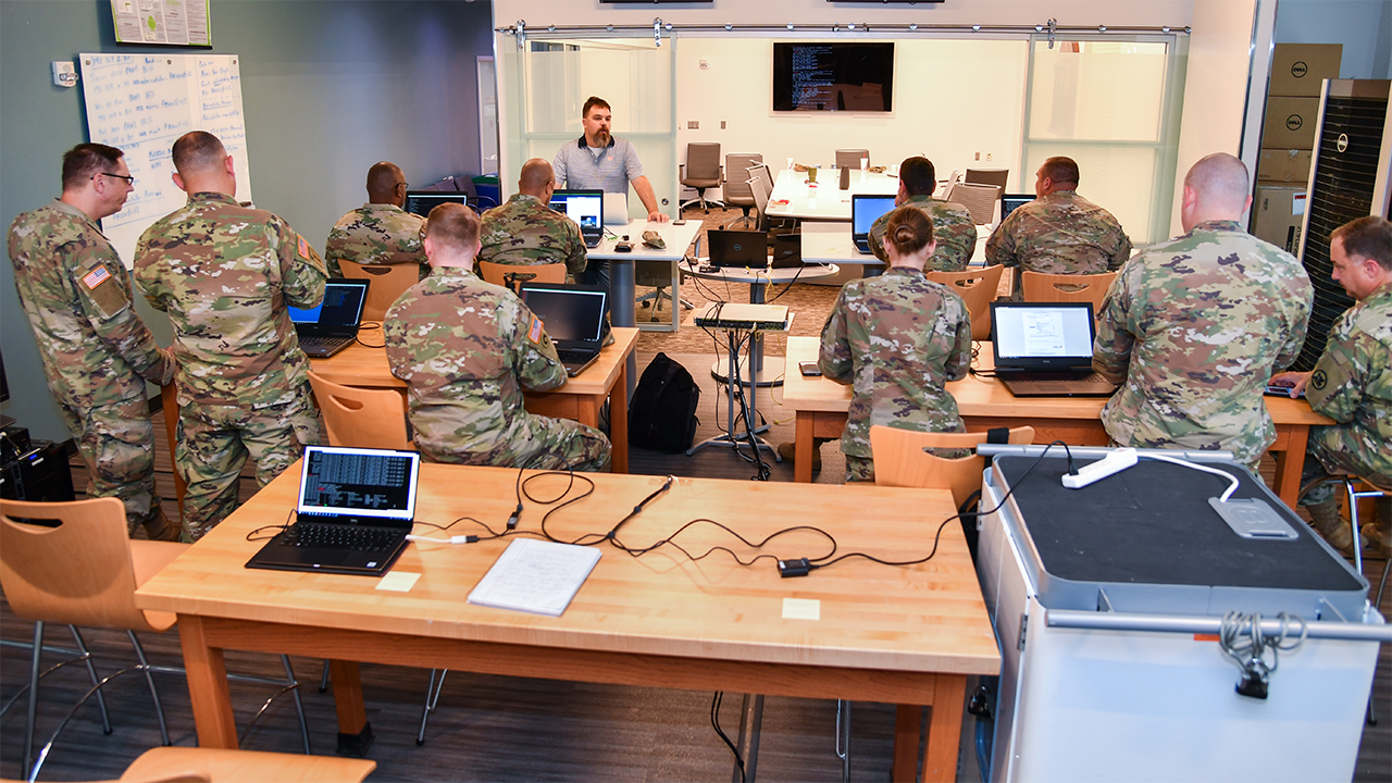 Jason Cuneo leads a session with Alabama National Guard members.