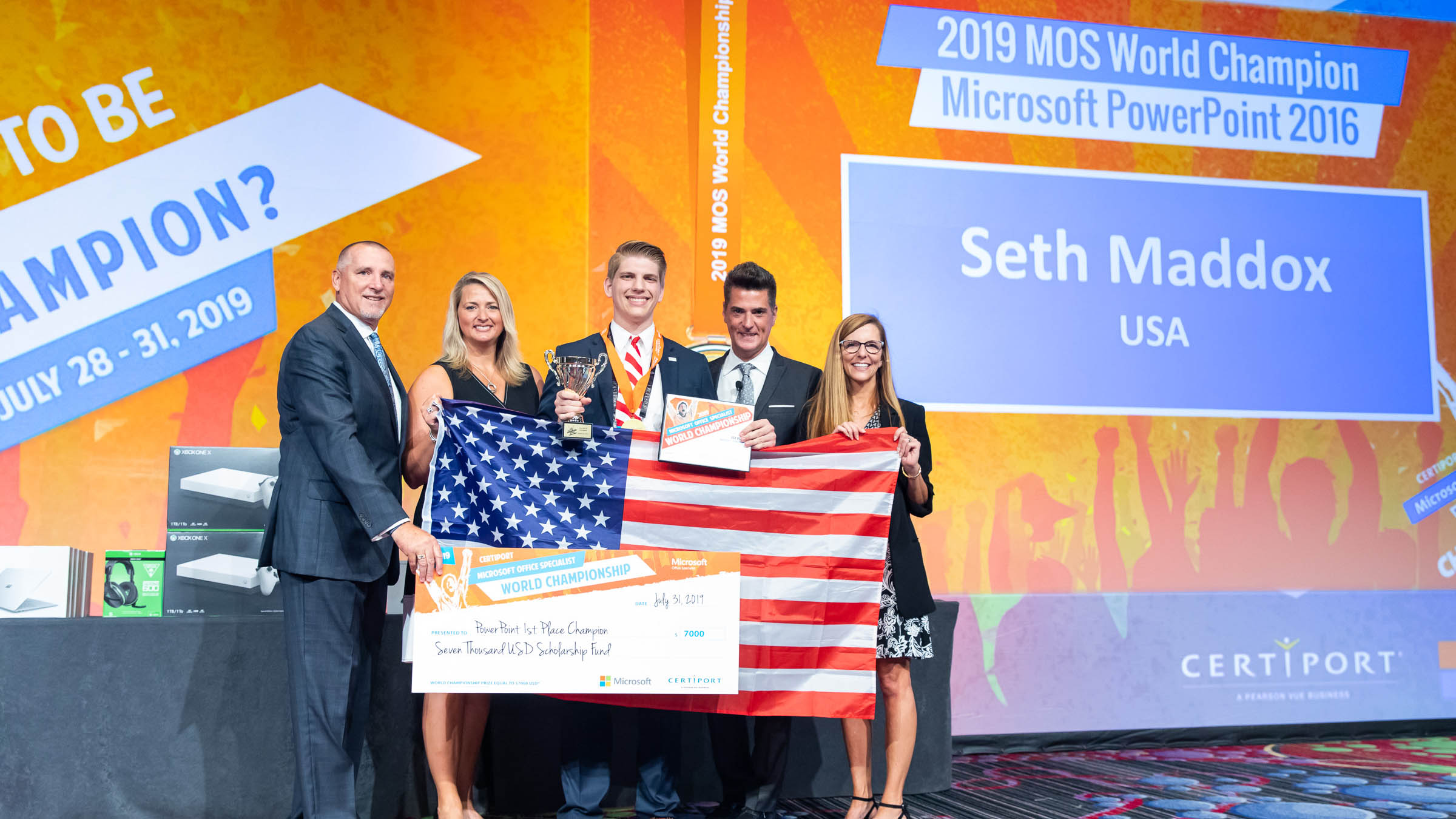 Incoming Auburn University freshman Seth Maddox was crowned the 2019 Microsoft Office Specialist PowerPoint World Champion on July 31 in New York. Pictured, from left, are Don Wagner and Nancy Jerdee with Pearson, Maddox, and Anthony Salcito and Jennifer Filarski with Microsoft.