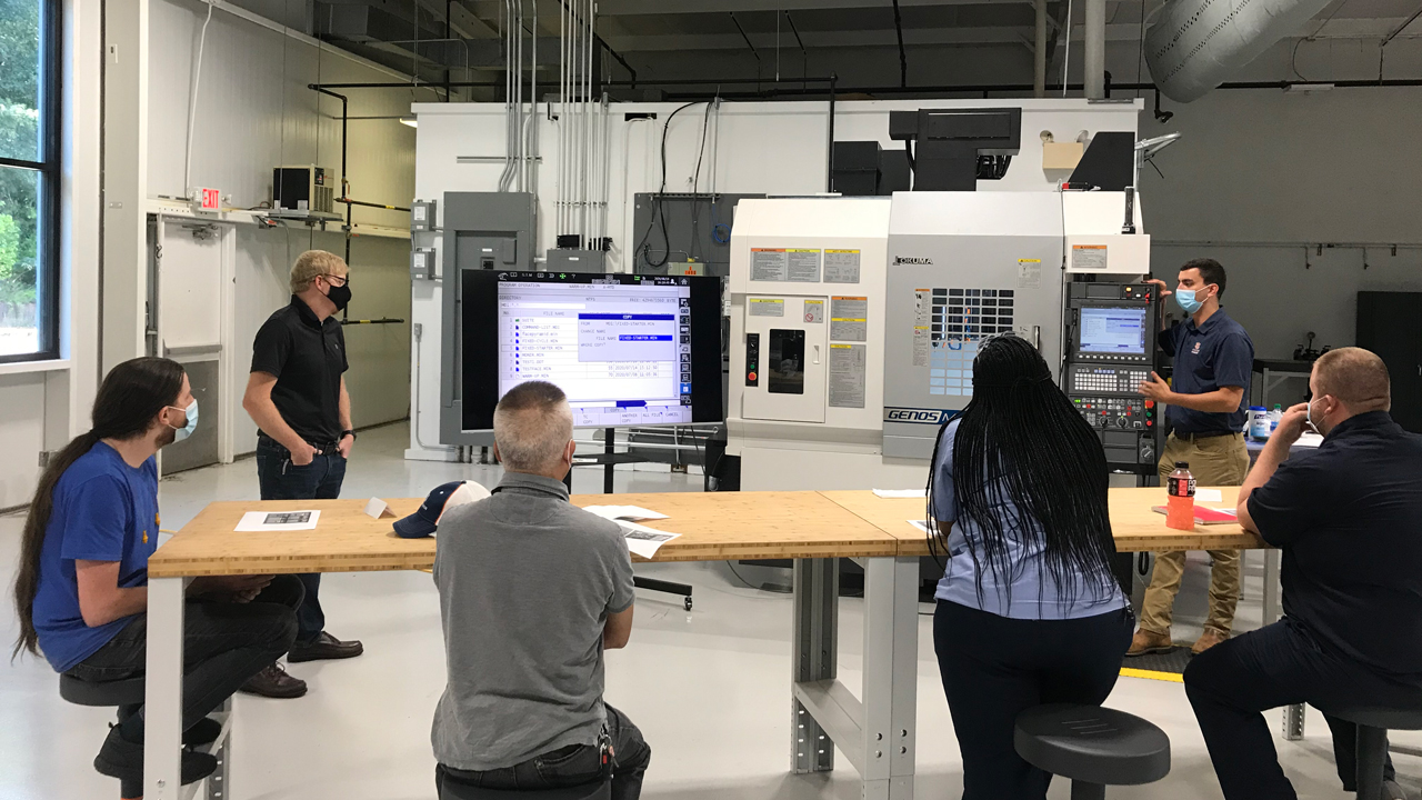 Auburn Engineering graduate assistants conduct a training session at the Auburn Advanced Manufacturing Training Center.