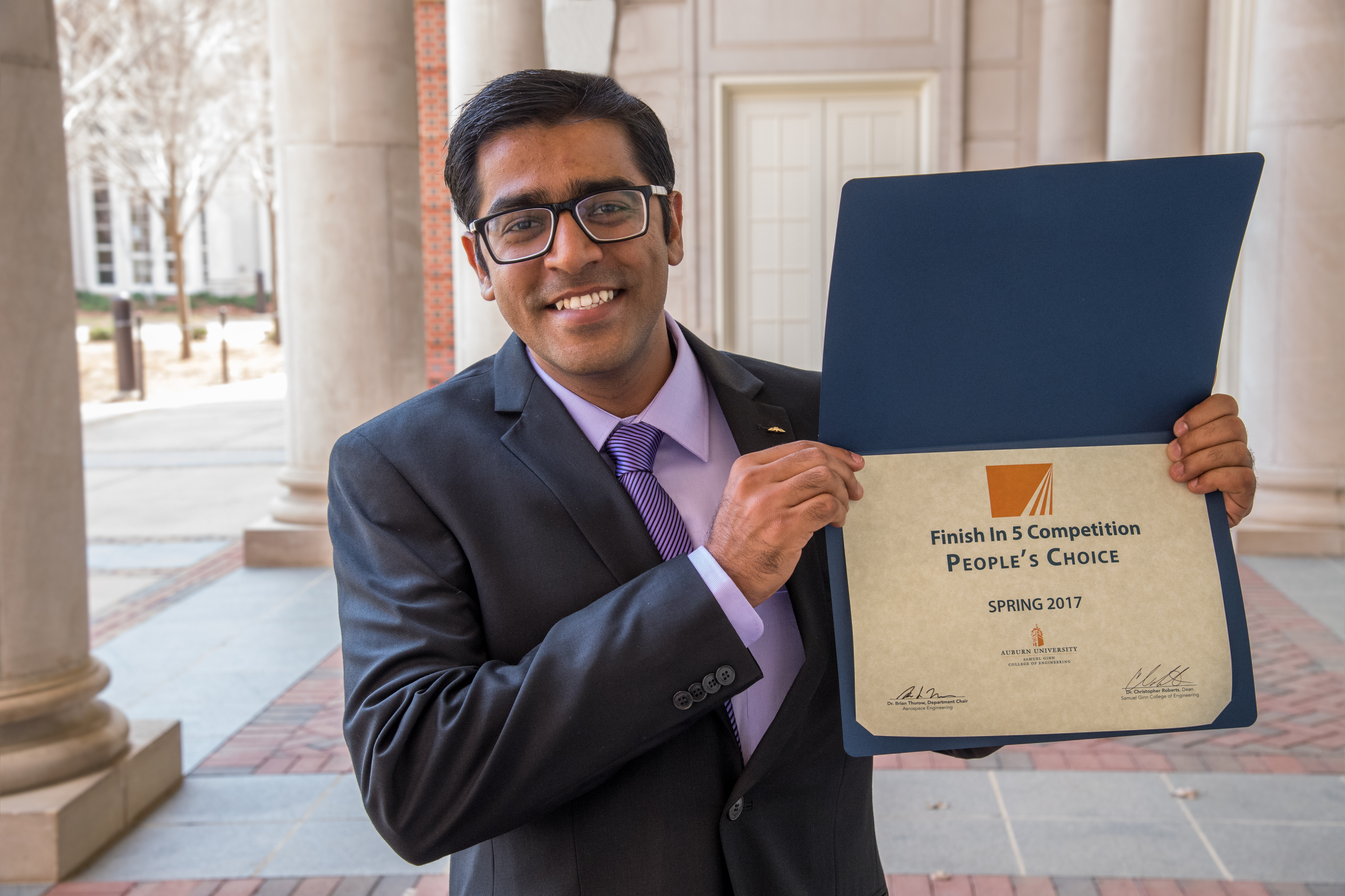 Mehul Barde is shown with his award certificate.