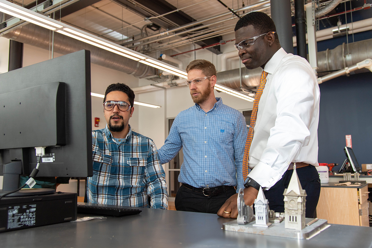 Emmanuel Winful (right) is pictured with researchers from the National Center for Additive Manufacturing Excellence.