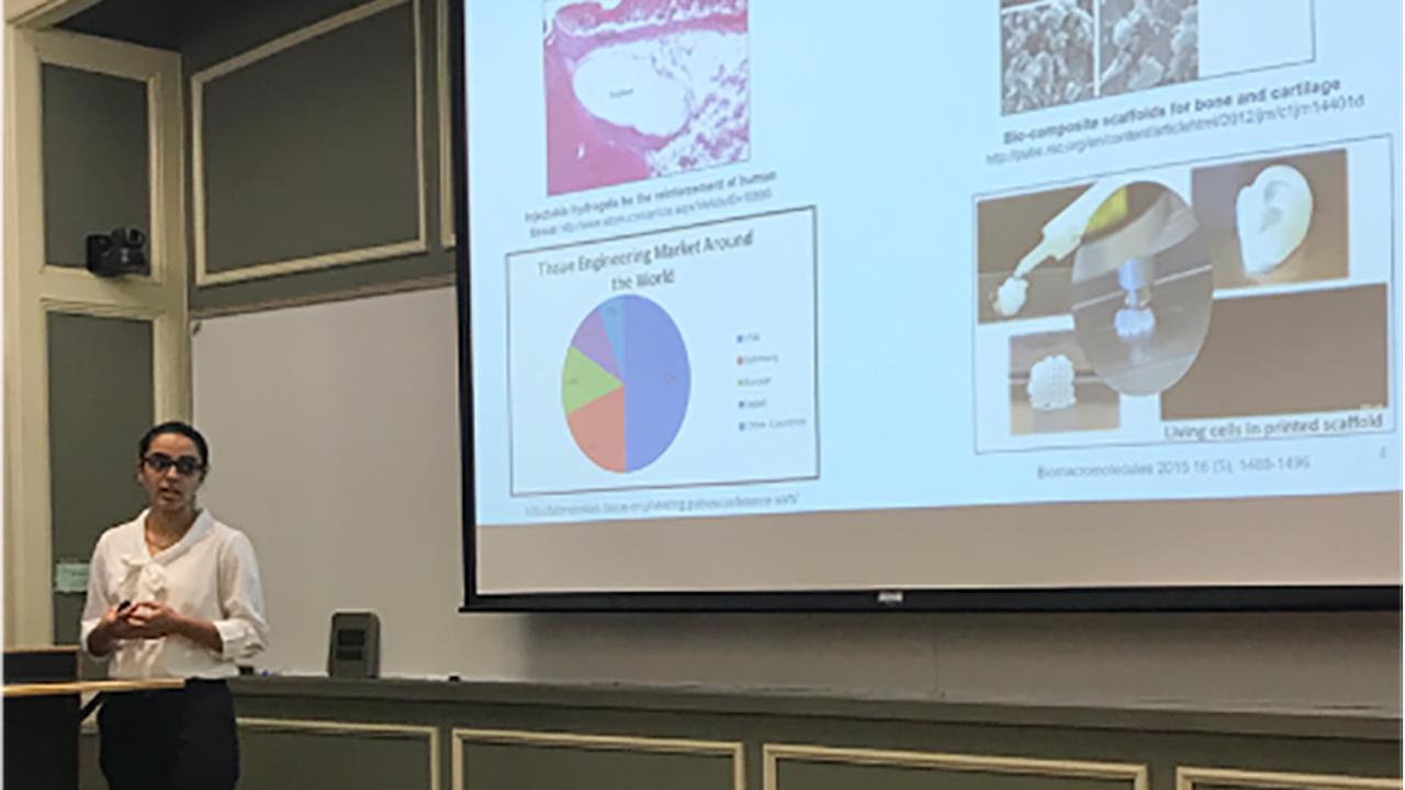 A graduate student presents her research at the annual Graduate Summer Seminar Series.
