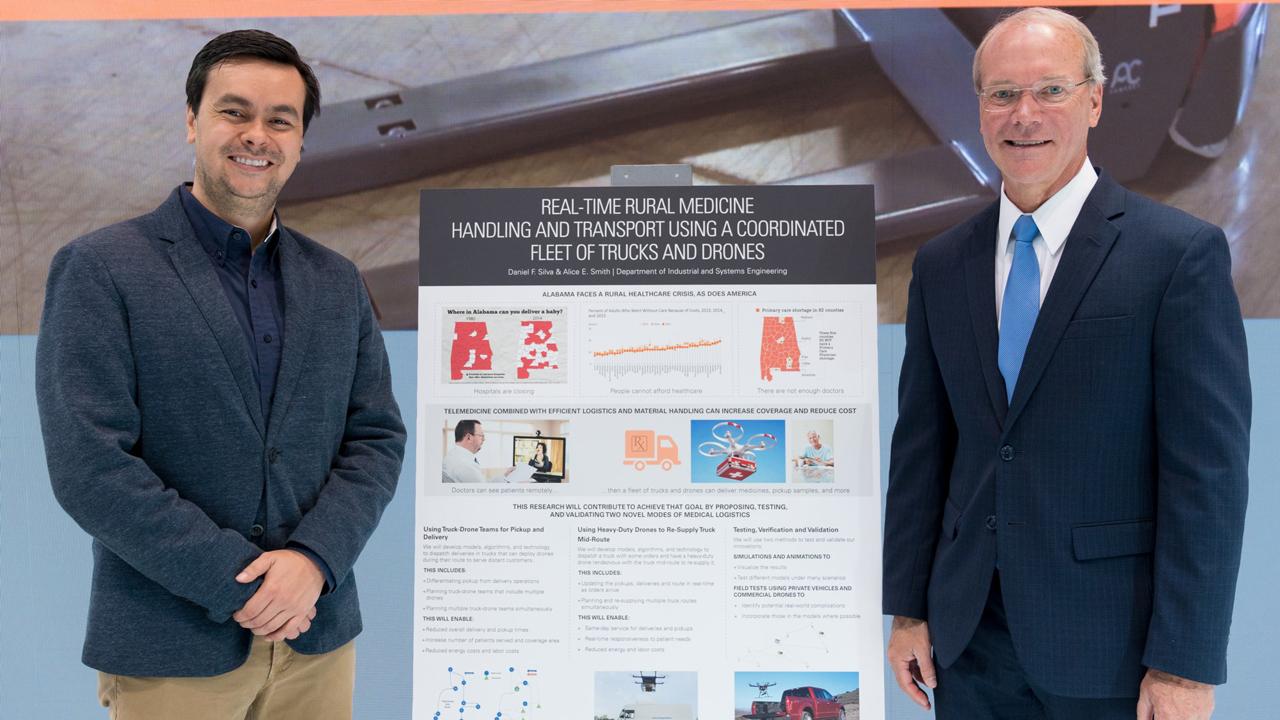 Assistant professor Daniel Silva with Toyota Material Handling North America CEO Brett Wood.