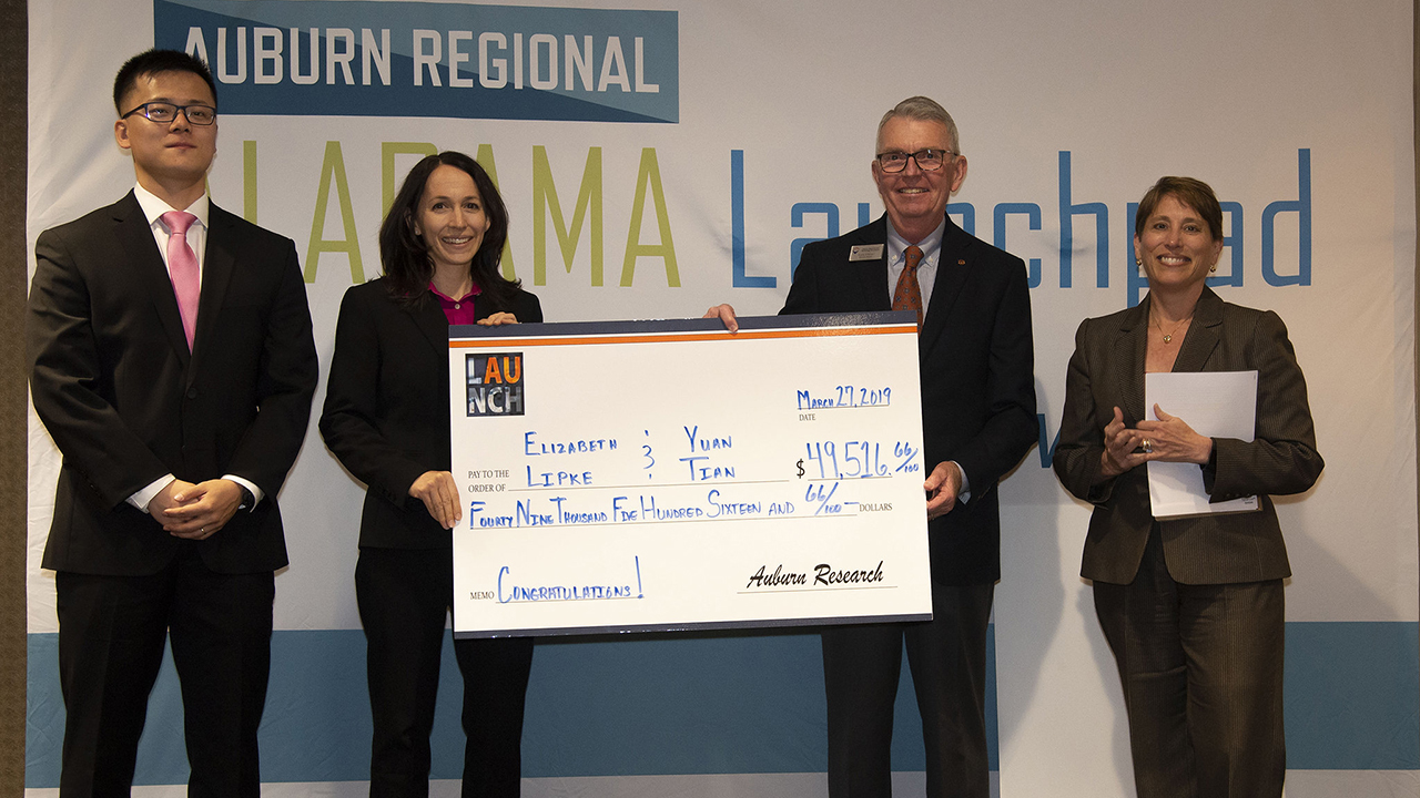 """Yuan Tian and Elizabeth Lipke of the Department of Chemical Engineering received Auburn University LAUNCH funding for """"Flexible microfluidic platform for rapid production of uniform cell-laden hydrogel microtissues."""" Pictured, from left, are Tian, Lipke, Larry Fillmer, Auburn executive director of external engagement and support, and Jennifer Kerpelman, Auburn interim vice president for research."""