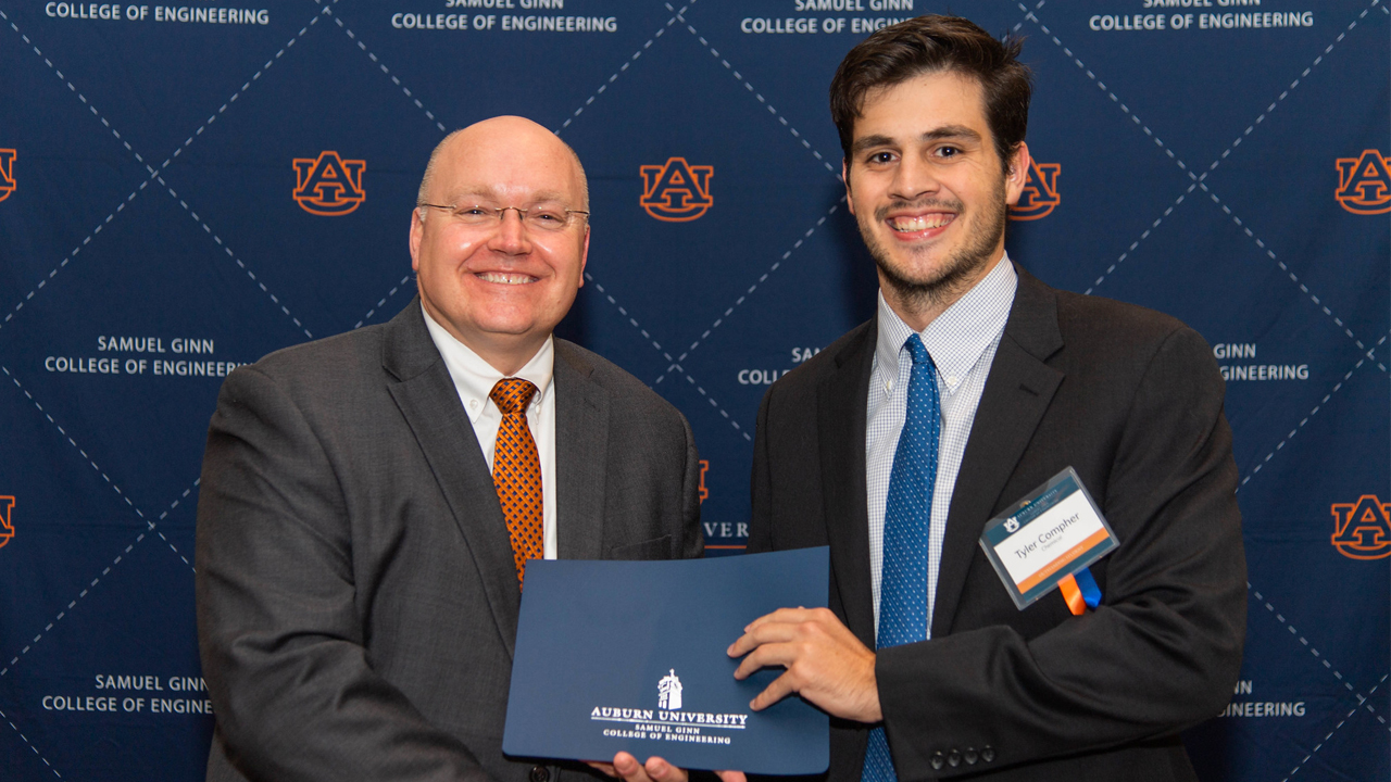 Outstanding Chemical Engineering Student Tyler Compher is pictured with Dean Christopher B. Roberts.