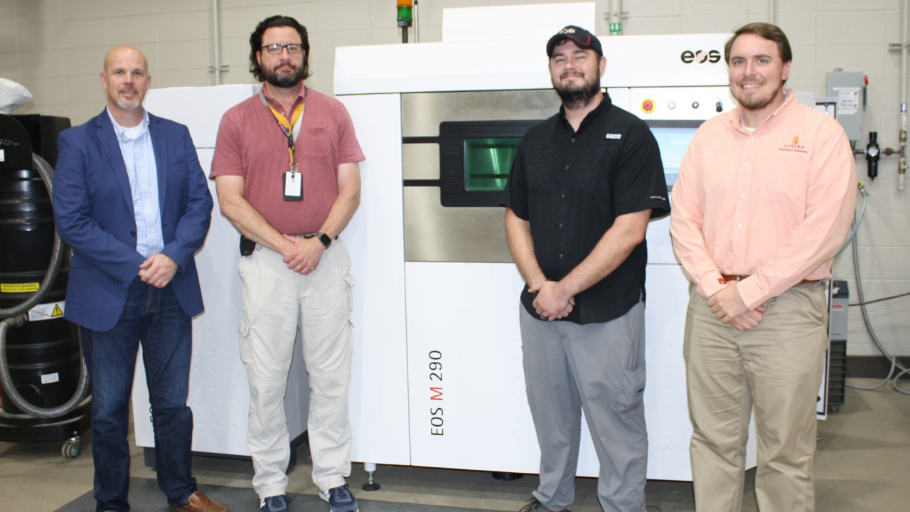 Team members from NCAME, Huntsville City Schools, and EOS worked together to bring online the district's second industrial 3D printer at Grissom High School. From left: Todd Watkins, director of Career Technical Education for Huntsville City Schools; Chris Faust, additive manufacturing teacher at Grissom High School; Garrett Heath, technician at EOS North America, and Lee Fleming, graduate research assistant for NCAME.