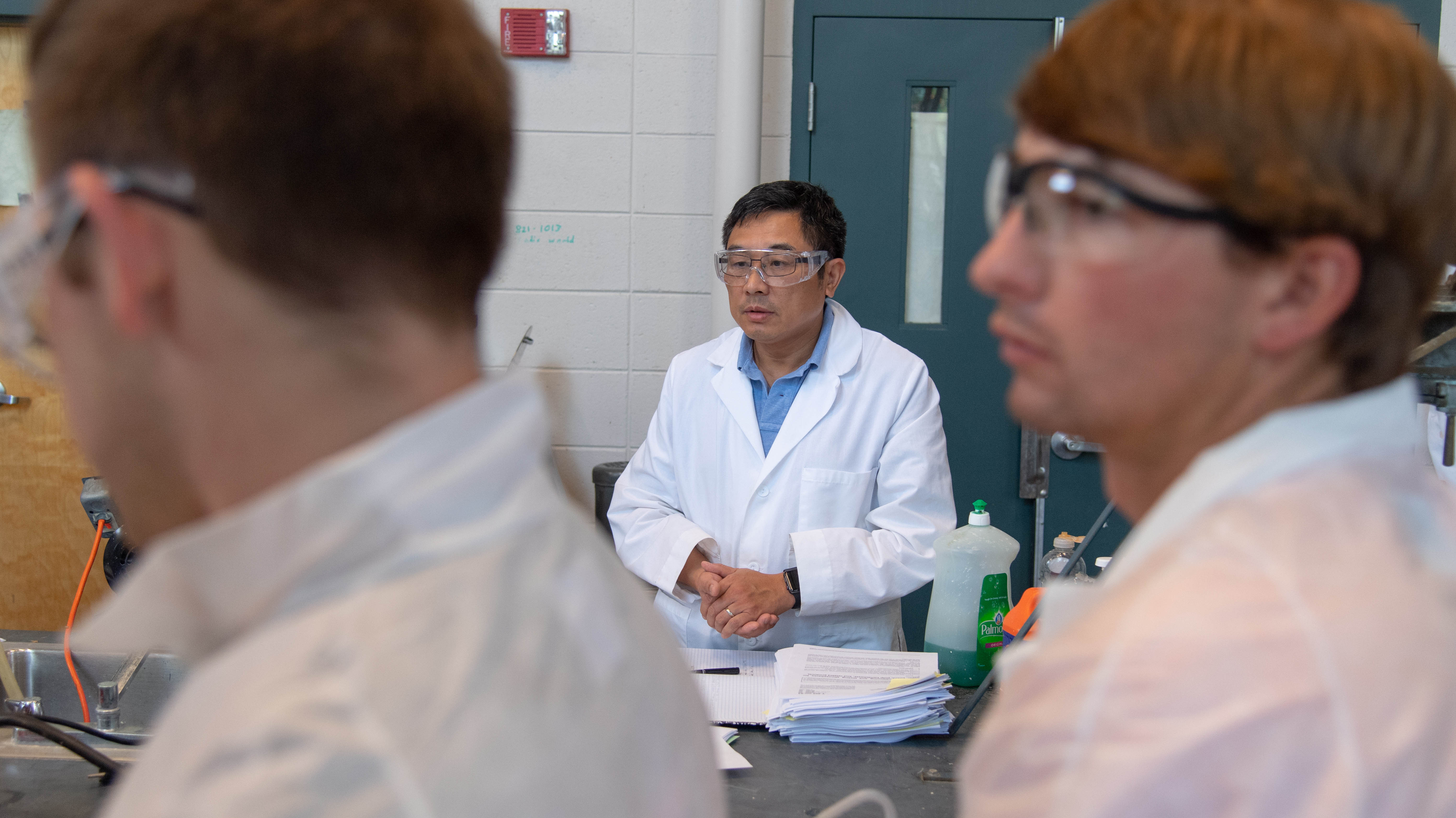 APPF Director Zhihua Jiang, assistant professor of chemical engineering in the Samuel Ginn College of Engineering, oversees students in the lab.