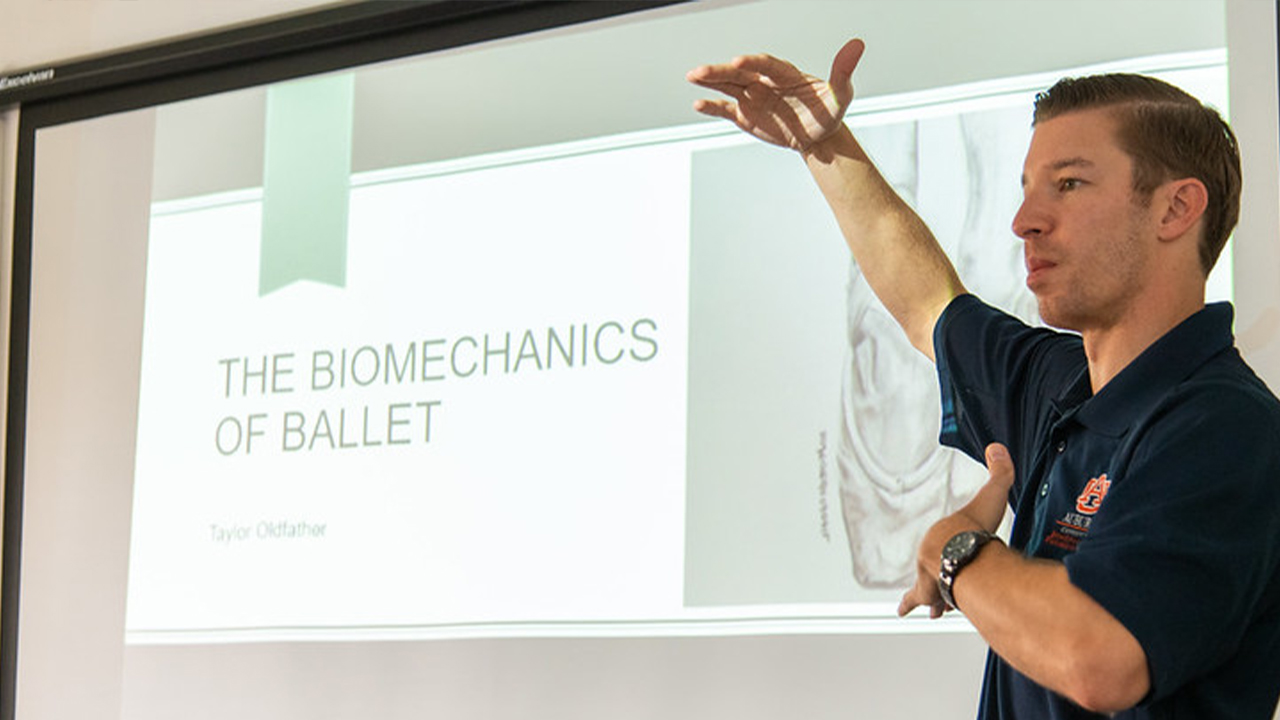 """Michael Zabala, assistant professor of mechanical engineering, lectures during the 2019 """"Biomechanics and Engineering in the Arts"""" study abroad program in Florence, Italy."""