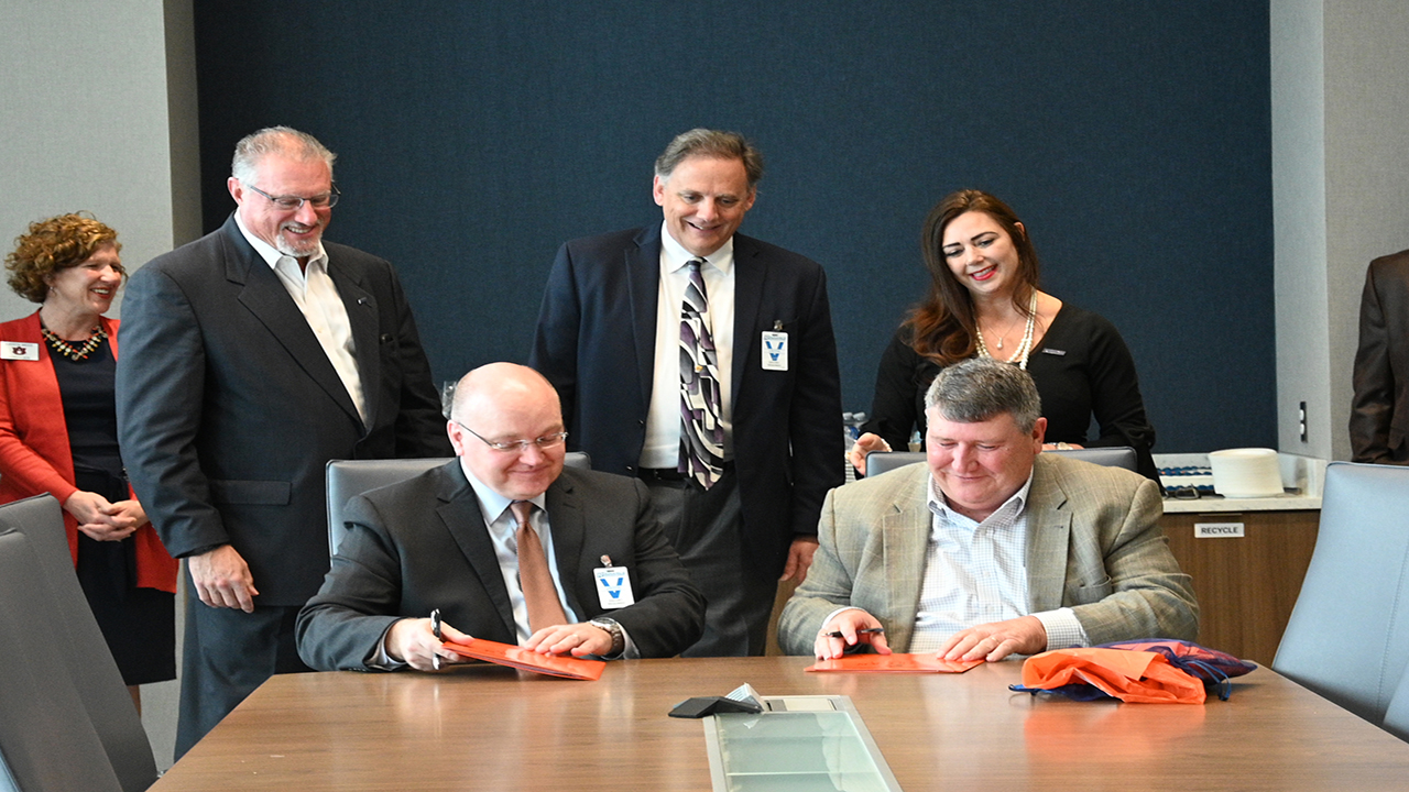 Auburn Engineering and Radiance Technologies sign the cohort agreement.