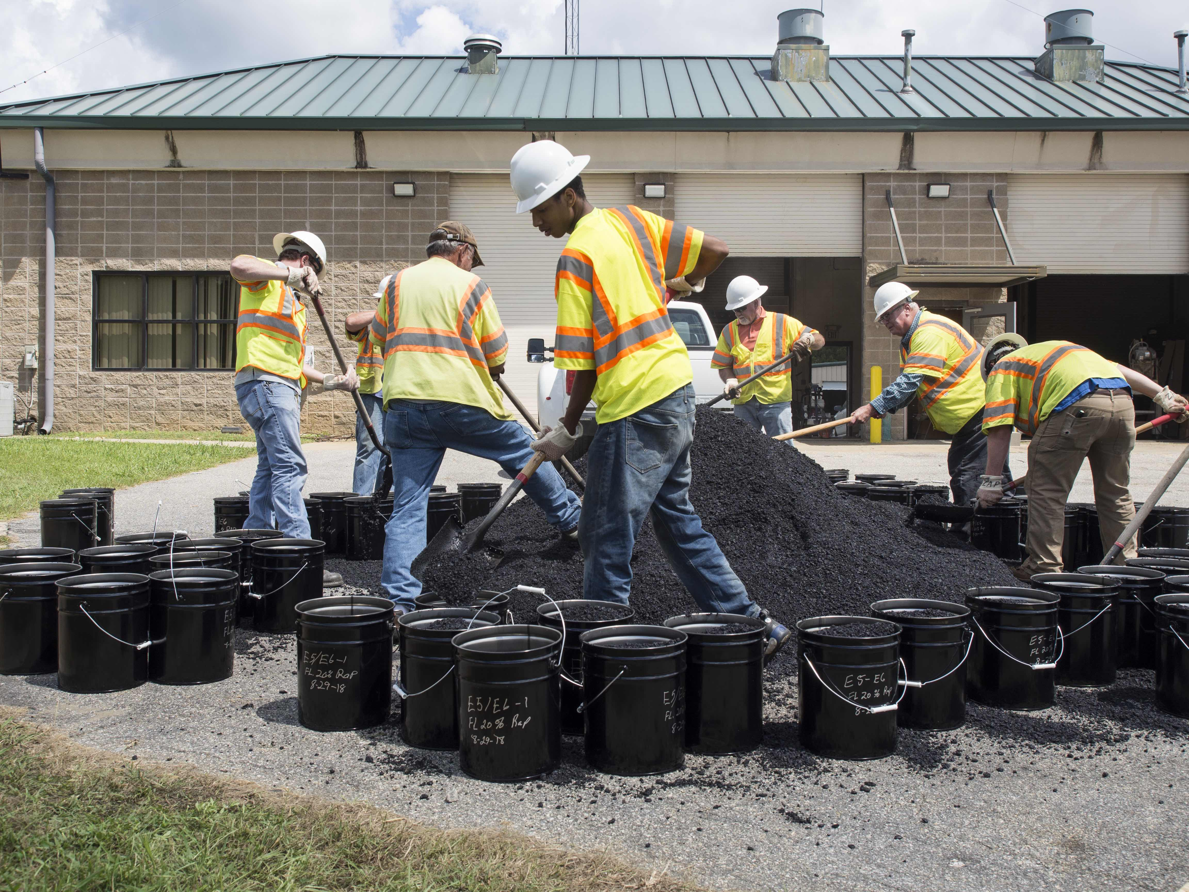 NCAT employees and students shoveled over 1000 buckets of asphalt mix during construction for laboratory testing.